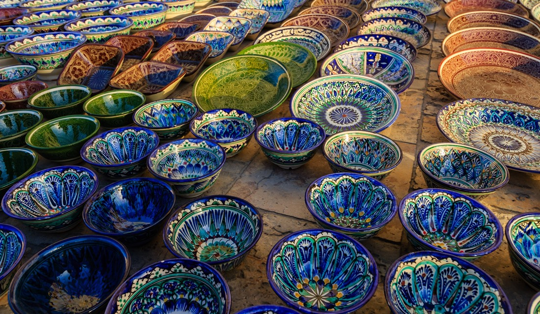 Bright hand-painted decorative plates for sale at Bukhara Bazaar