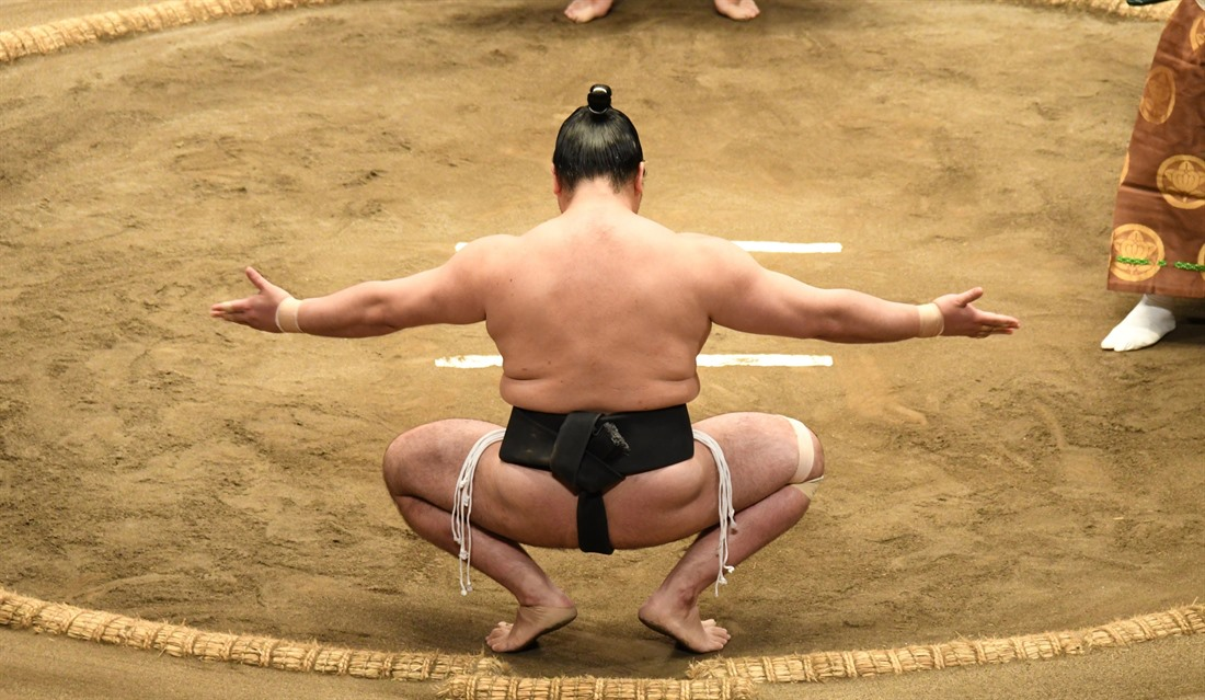 A contestant prepares to take on his rival on the final day of a sumo tournament in Tokyo