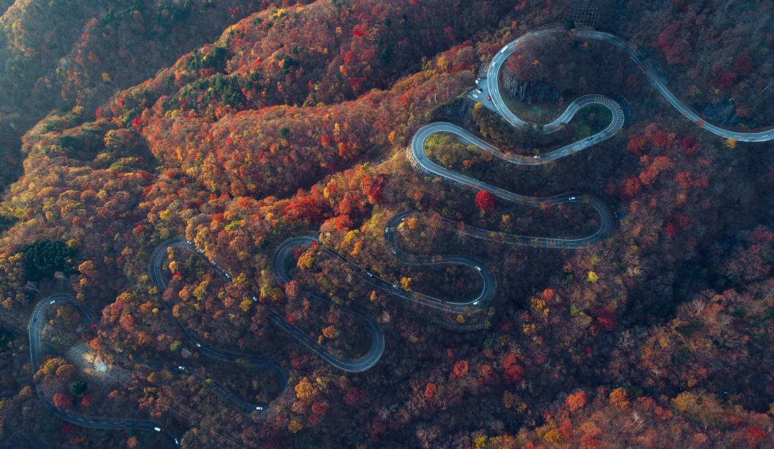 A road winds down a hill near Nikko in Tochigi prefecture