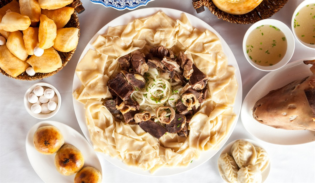 Traditional Kazakh dishes on display. © Shutterstock/iPostnikov