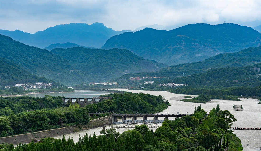 A view of the Dujiangyan Irrigation System and mountain backdrop