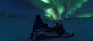 Northern Lights by snowmobile