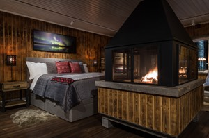 Bedroom by the fire at Logger's Lodge