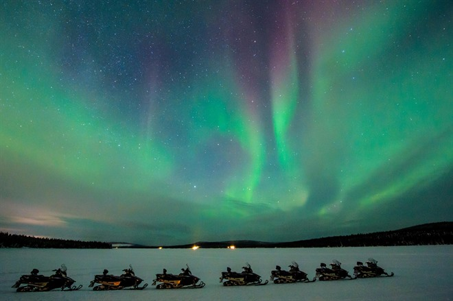 Snowmobiling under the northern Lights ©Asaf Kliger, ICEHOTEL