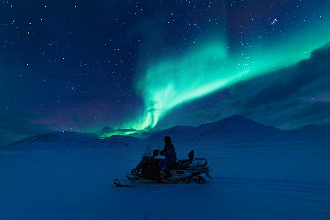Snowmobiling Northern Lights in Svalbard