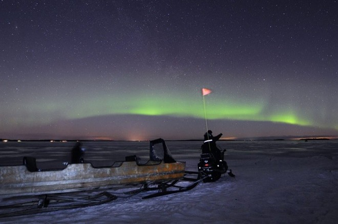 Hunting for the northern lights by snowmobile sled