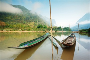 Long tail boats on the Mekong River in Laos