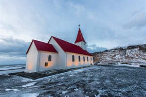 Old red wooden church in Vik